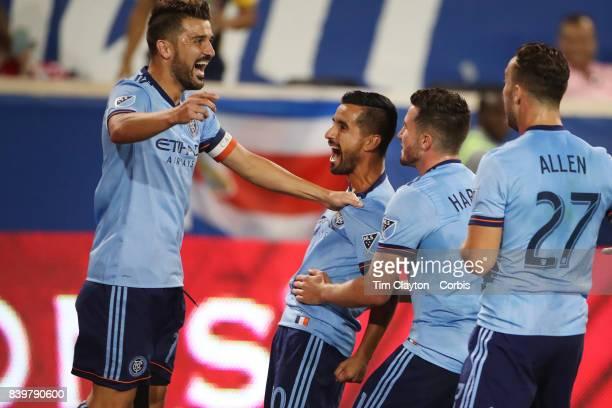 David Villa of New York City FC celebrates with goal scorer Maximiliano Moralez of New York City FC and team mates Jack Harrison of New York City FC...