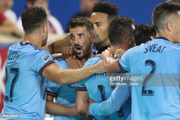 David Villa of New York City FC celebrates with goal scorer Maximiliano Moralez of New York City FC and team mates RJ Allen of New York City FC...
