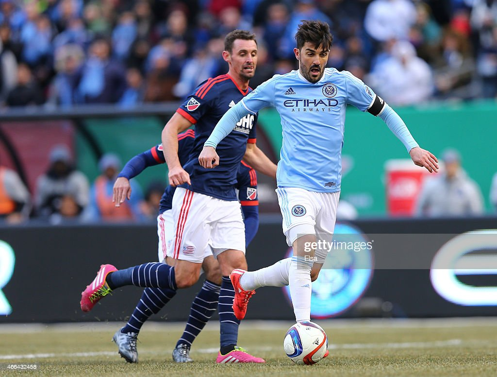 David Villa #7 of New York City FC drives to the net in the first half as Andy Dorman #12 of New England Revolution defends during the inaugural game of the New York City FC at Yankee Stadium on March 15, 2015 in the Bronx borough of New York City.
