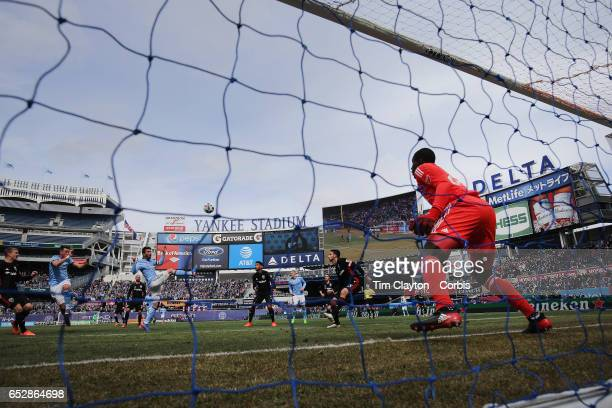David Villa of New York City FC heads the first of his two goals beating goalkeeper Bill Hamid of DC United during the NYCFC Vs DC United regular...
