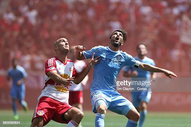 David Villa of New York City FC is challenged by Aurelien Collin of New York Red Bulls during the New York Red Bulls Vs New York City FC MLS regular...