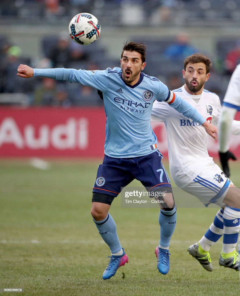 David Villa #7 of New York City FC is challenged by Hernan Bernardello #30 of Montreal Impact during the New York City FC Vs Montreal Impact regular season MLS game at Yankee Stadium on March 18, 2017 in New York City.