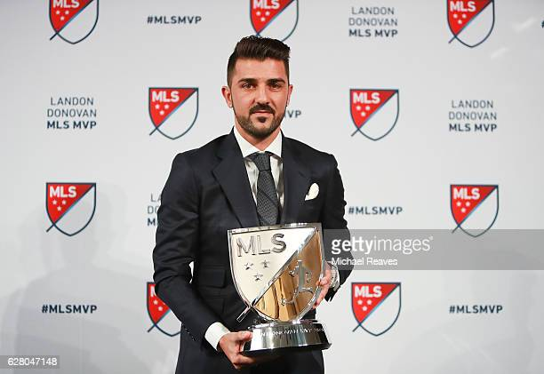 David Villa of New York City FC poses for a photo with the 2016 Landon Donovan MLS MVP trophy at Spring Studios on December 6, 2016 in New York City.