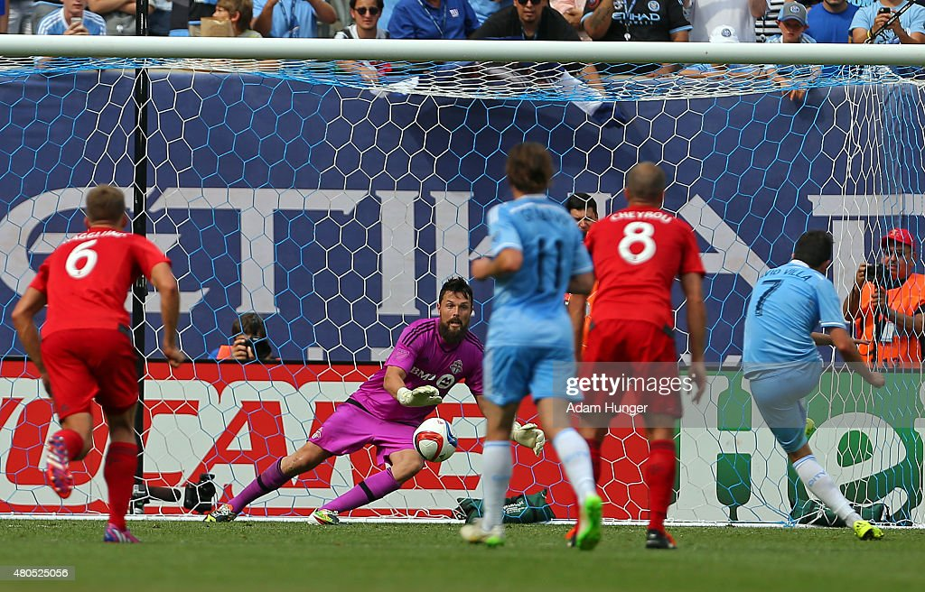 David Villa #7 of New York City FC scores on a penalty kick past Chris Konopka #1 of Toronto FC during a soccer game at Yankee Stadium on July 12, 2015 in the Bronx borough of New York City.