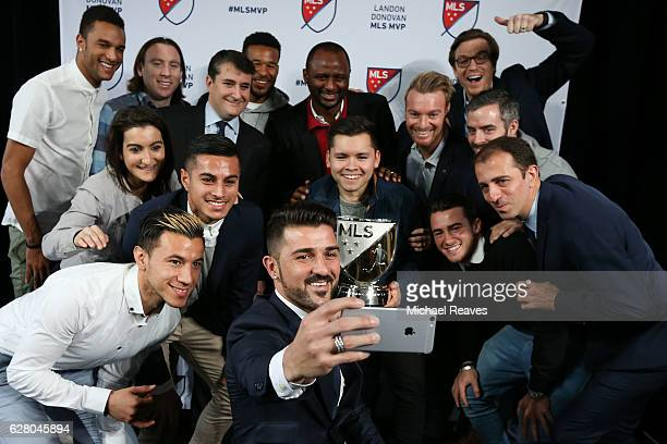 David Villa of New York City FC takes a photo with his New York City FC teammates after being presented with the 2016 Landon Donovan MLS MVP trophy...