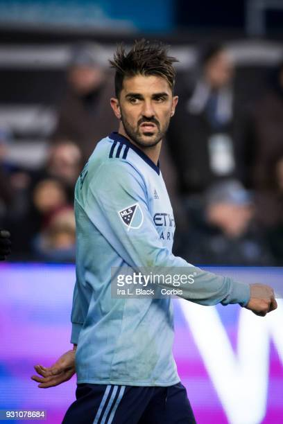 David Villa of New York City gives a look back at David Bingham of Los Angeles Galaxy during the MLS Regular Season Home Opener between New York City...