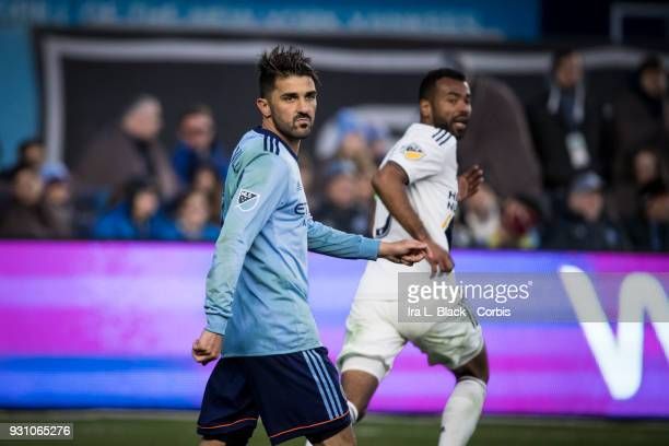 David Villa of New York City heads back with Ashley Cole of Los Angeles Galaxy during the MLS Regular Season Home Opener between New York City FC and...