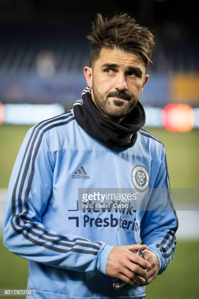 David Villa of New York City heads to the locker room with ice on his leg after an injury during the MLS Regular Season Home Opener between New York...