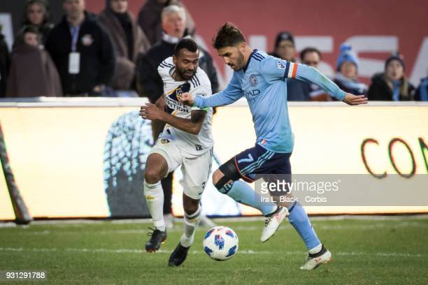David Villa of New York City tangles with Ashley Cole of Los Angeles Galaxy just before Cole gets a 2nd yellow card of the match during the MLS...