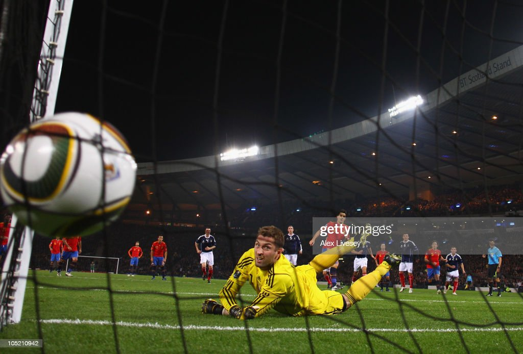 David Villa of Spain beats Allan McGregor of Scotland from the penalty spot for the opening goal during the UEFA EURO 2012 Group I Qualifier match between Scotland and Spain at Hampden Park on October 12, 2010 in Glasgow, Scotland.