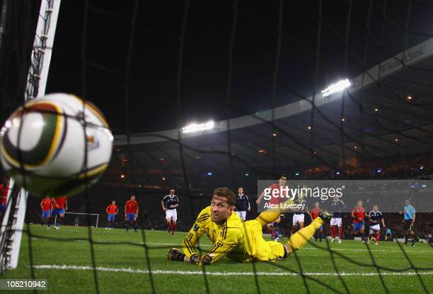 David Villa of Spain beats Allan McGregor of Scotland from the penalty spot for the opening goal during the UEFA EURO 2012 Group I Qualifier match...