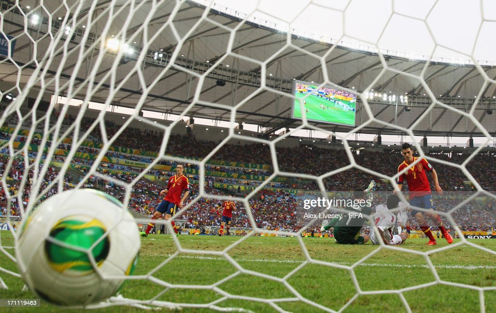 David Villa of Spain beats goalkeeper Mickael Roche of Tahiti to score his first goal during the FIFA Confederations Cup Brazil 2013 Group B match between Spain and Tahiti at the Maracana Stadium on June 20, 2013 in Rio de Janeiro, Brazil.