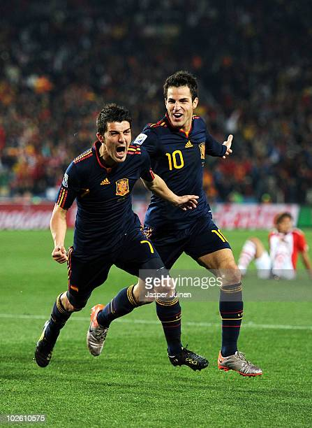 David Villa of Spain celebrates after he scores his side's first goal with team mate Francesc Fabregas during the 2010 FIFA World Cup South Africa...