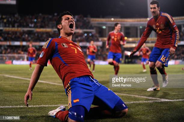 David Villa of Spain celebrates after scoring his second goal during the UEFA EURO 2012 qualifier between Spain and Czech Republic at Los Carmenes...