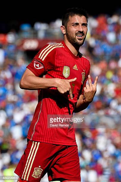 David Villa of Spain celebrates after scoring his team's second goal during an international friendly match between El Salvador and Spain at...