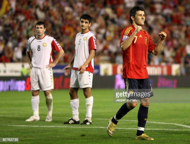 David Villa of Spain celebrates his goal as Robert Arzumanyan and Artur Voskanyan of Armenia look on during the FIFA2010 World Cup Qualifying match...