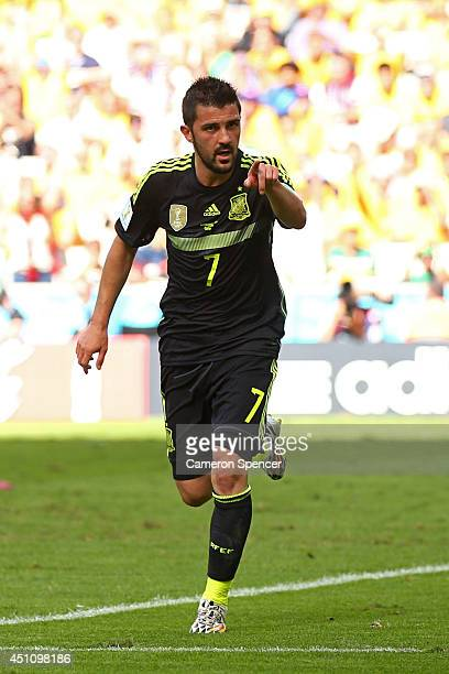 David Villa of Spain celebrates scoring his team's first goal during the 2014 FIFA World Cup Brazil Group B match between Australia and Spain at...