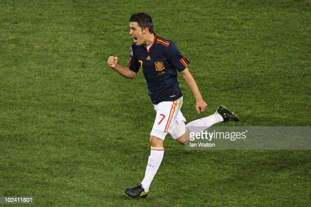 David Villa of Spain celebrates scoring the opening goal during the 2010 FIFA World Cup South Africa Group H match between Chile and Spain at Loftus...