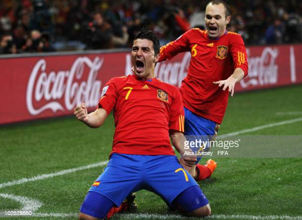 David Villa of Spain celebrates scoring the opening goal with teammate Andres Iniesta during the 2010 FIFA World Cup South Africa Round of Sixteen...