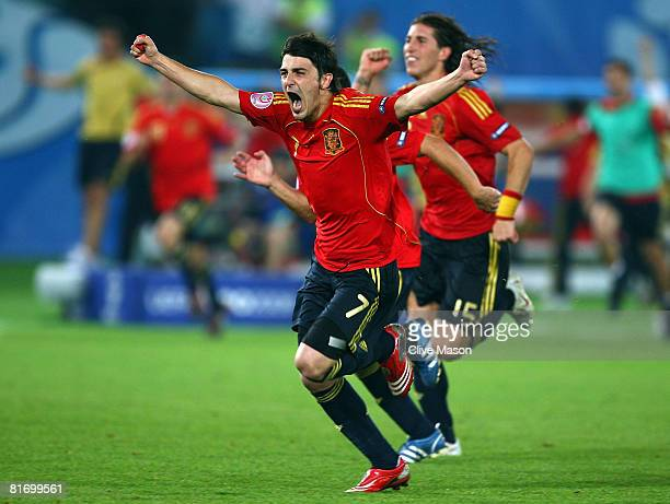 David Villa of Spain celebrates victory with team mate Sergio Ramos in the UEFA EURO 2008 Quarter Final match between Spain and Italy at Ernst Happel...
