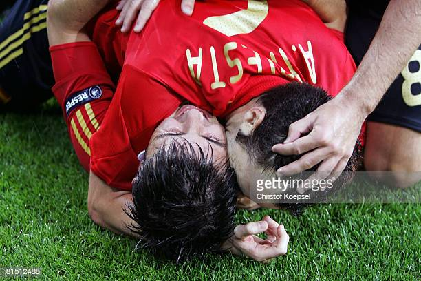 David Villa of Spain celebrates with Andres Iniesta after scoring the second goal during the UEFA EURO 2008 Group D match between Spain and Russia at...