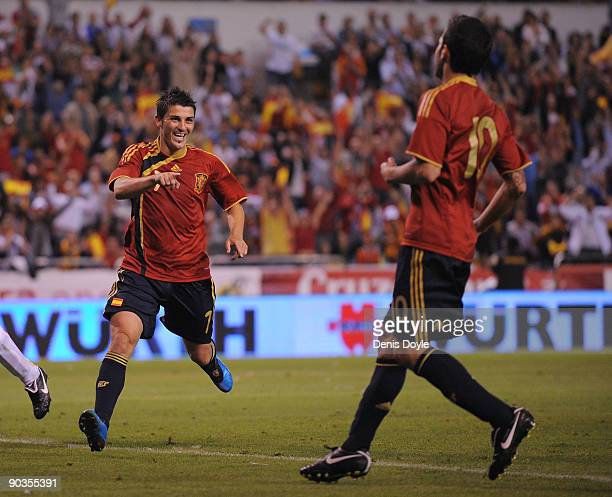 David Villa of Spain celebrates with Cesc Fabregas after scoring Spain's fourth goal during the Group 5 FIFA2010 World Cup Qualifier match between...