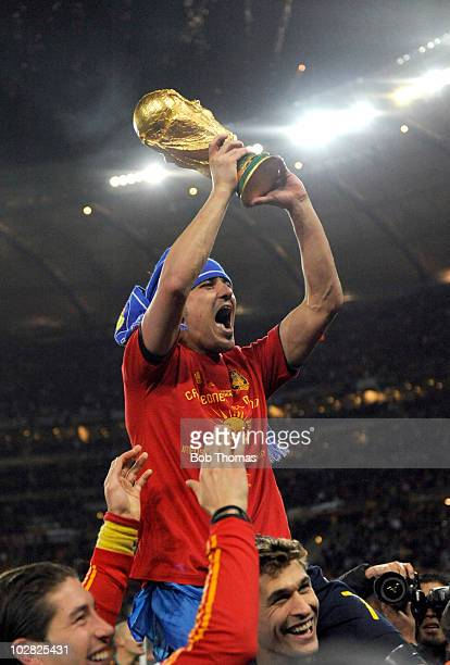 David Villa of Spain celebrates with the trophy after the 2010 FIFA World Cup Final between the Netherlands and Spain on July 11 2010 in Johannesburg...