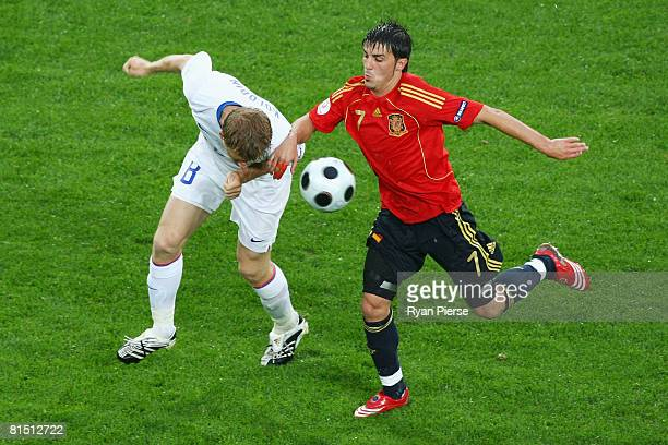 David Villa of Spain is beaten to the ball by Denis Kolodin of Russia during the UEFA EURO 2008 Group D match between Spain and Russia at Stadion...