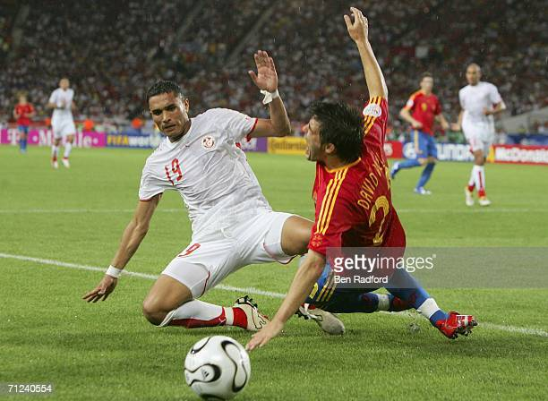 David Villa of Spain is brought down by Anis Ayari of Tunisia during the FIFA World Cup Germany 2006 Group H match between Spain and Tunisia at the...