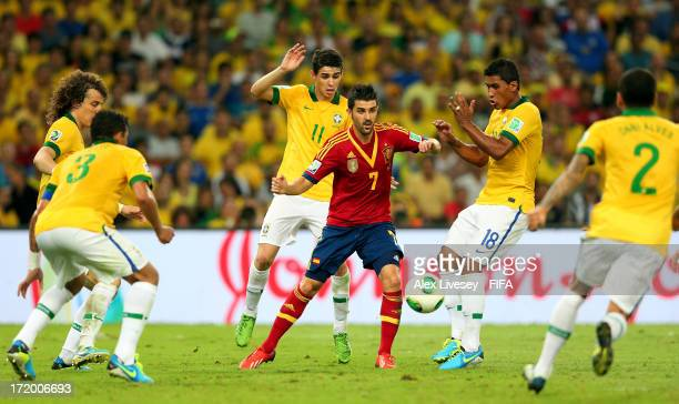 David Villa of Spain is closed down by Oscar and Paulinho of Brazil during the FIFA Confederations Cup Brazil 2013 Final match between Brazil and...