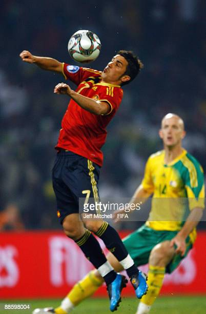 David Villa of Spain jumps for the ball during the FIFA Confederations Cup match between Spain and South Africa at the Free State stadium on June 20,...