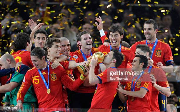 David Villa of Spain kisses the trophy and celebrates with teammates after the 2010 FIFA World Cup Final between the Netherlands and Spain on July 11...
