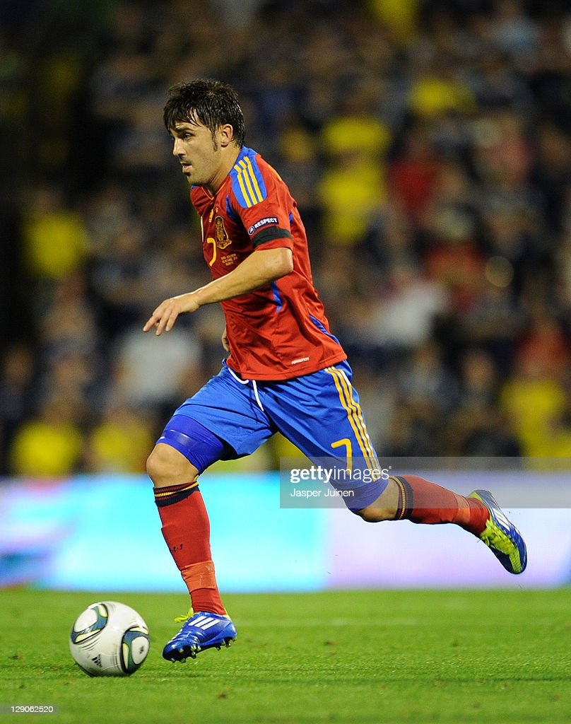 David Villa of Spain runs with the ball during the UEFA EURO 2012 Group I Qualifier between Spain and Scotland at the Rico Perez stadium on October 11, 2011 in Alicante, Spain.