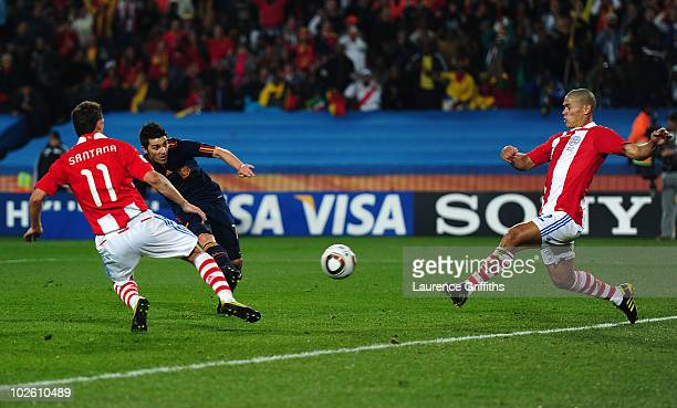 David Villa of Spain scores his side's first goal during the 2010 FIFA World Cup South Africa Quarter Final match between Paraguay and Spain at Ellis...