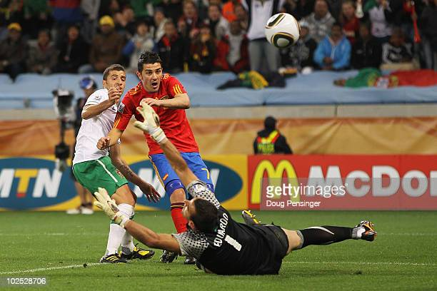 David Villa of Spain scores his side's first goal past Eduardo of Portugal during the 2010 FIFA World Cup South Africa Round of Sixteen match between...