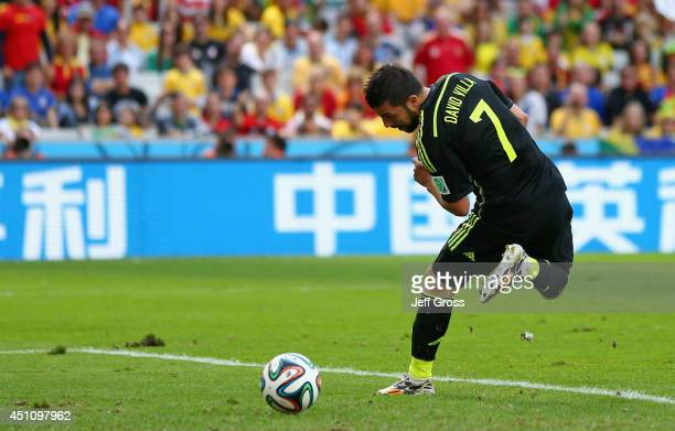 David Villa of Spain scores his team's first goal during the 2014 FIFA World Cup Brazil Group B match between Australia and Spain at Arena da Baixada...