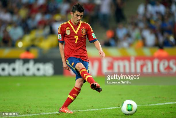 David Villa of Spain scores his team's seventh goal to complete his hattrick during the FIFA Confederations Cup Brazil 2013 Group B match between...