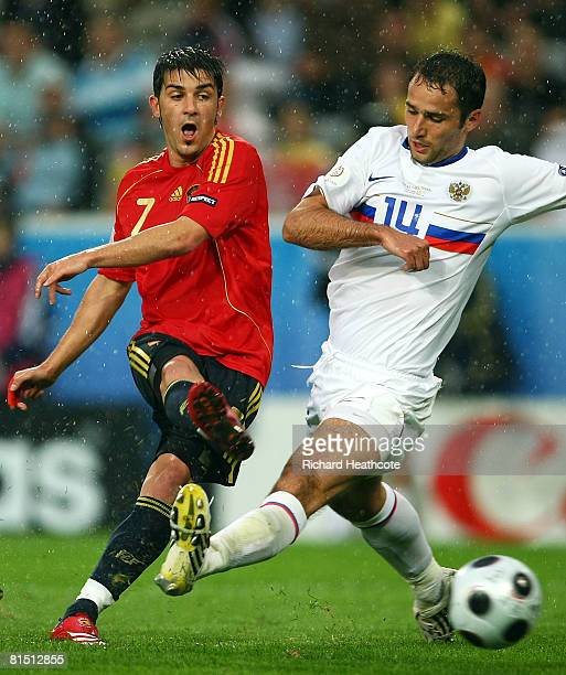 David Villa of Spain scores his third goal past Roman Shirokov of Russia during the UEFA EURO 2008 Group D match between Spain and Russia at Stadion...