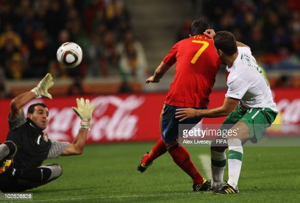 David Villa of Spain scores the opening goal past goalkeeper Eduardo of Portugal during the 2010 FIFA World Cup South Africa Round of Sixteen match...