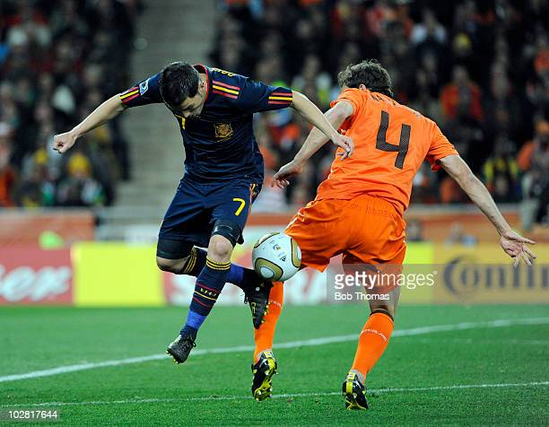 David Villa of Spain tackled by Joris Mathijsen of the Netherlands during the 2010 FIFA World Cup Final between the Netherlands and Spain on July 11...