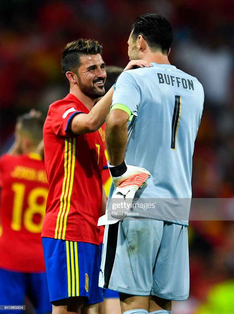 David Villa of Spain talks with Gianluigi Buffon of Italy at the end of the FIFA 2018 World Cup Qualifier between Spain and Italy at Estadio Santiago Bernabeu on September 2, 2017 in Madrid, Spain.