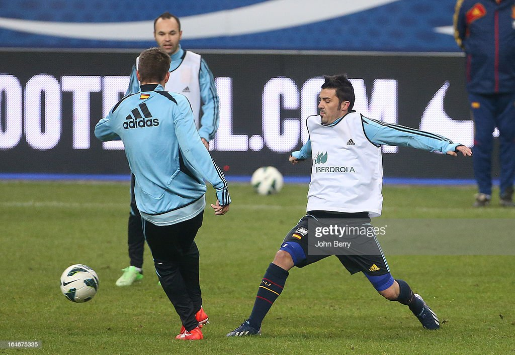 David Villa of Spain warms up during the practice session the day before the FIFA World Cup 2014 qualifier between France and Spain at the Stade de France on March 25, 2013 in Saint-Denis near Paris, France.