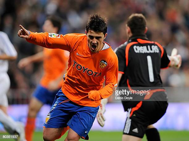 David Villa of Valencia celebrates after scoring his team's opening goal during the La Liga match between Real Madrid and Valencia at the Santiago...