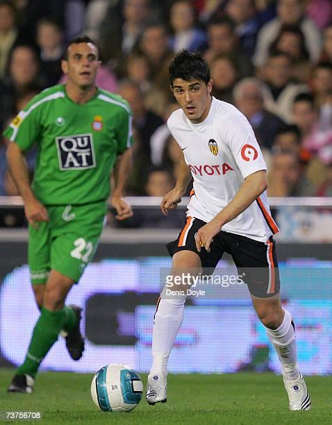 David Villa of Valencia goes past Moises Hurtado of Espanol during the Primera Liga match between Valencia and Espanol at the Mestalla stadium on...