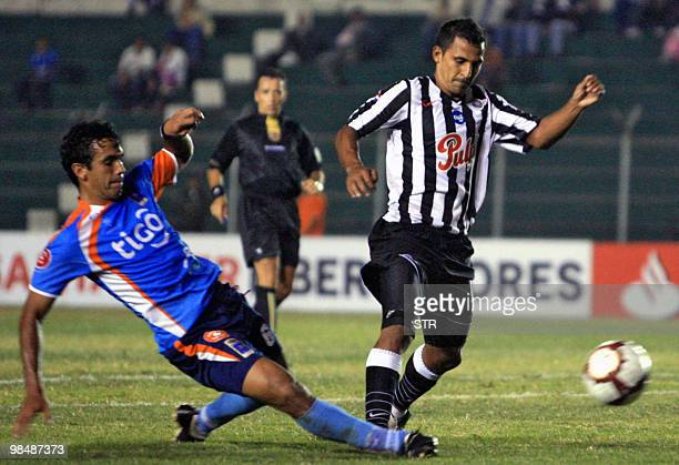 David Villalba of Bolivia's Blooming vies for the ball with Javier Gonzalez of Paraguayan Libertad on April 15 during a Libertadores Cup football...