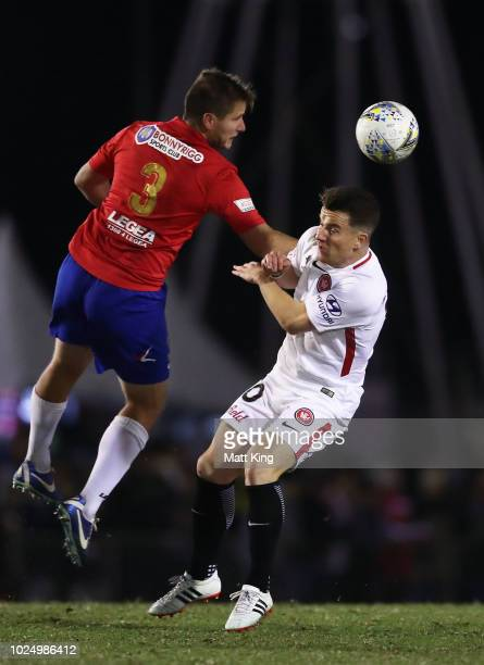 David Vrankovic of Bonnyrigg White Eagles FC competes for the ball against Alexander Baumjohann of the Wanderers during the FFA Cup round of 16 match...