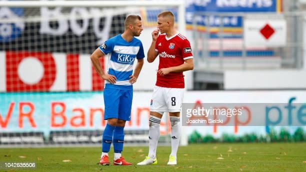 David Vrzogic of Meppen talk to Max Dombrowka of Unterhaching after the 3 Liga match between SV Meppen and SpVgg Unterhaching at HaenschArena on...