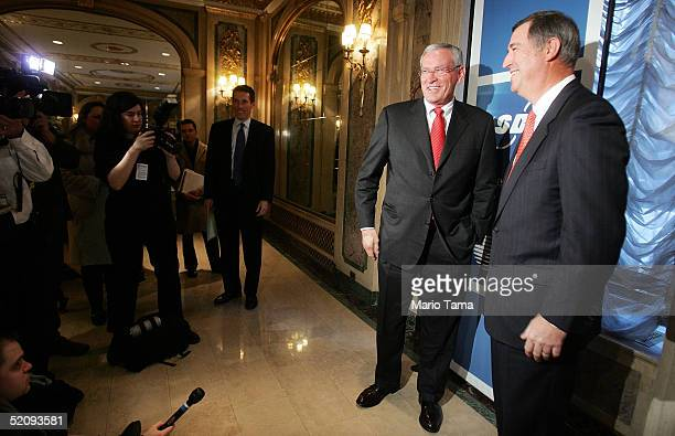 David W. Dorman, AT&T chairman and chief executive and Ed Whitacre, CEO of SBC pose for a photograph in the Plaza Hotel February 1, 2005 in New York...