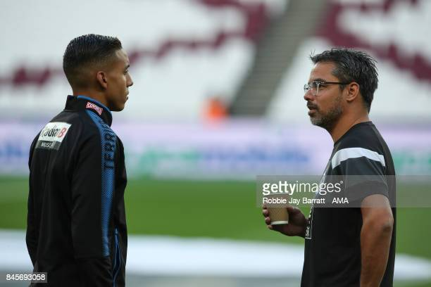 David Wagner head coach / manager of Huddersfield Town and Abdelhamid Sabiri of Huddersfield Town prior to the Premier League match between West Ham...