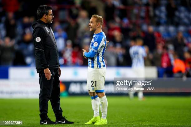 David Wagner head coach / manager of Huddersfield Town and Alex Pritchard of Huddersfield Town at full time during the Premier League match between...